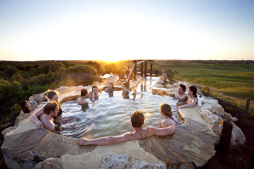 4 Bath House - Group enjoying sunset in the hilltop pool.jpg